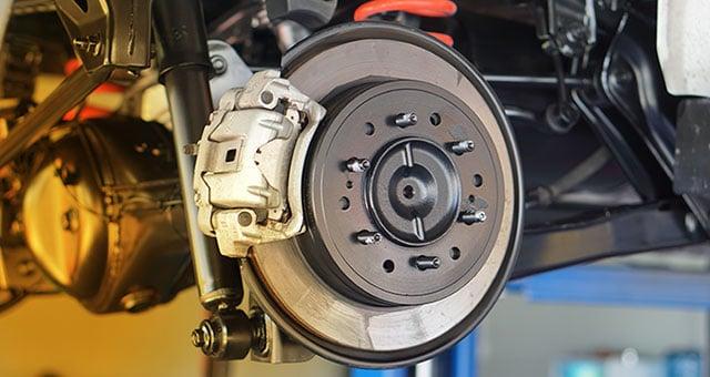Dumfries MOT Centre checking brake pads